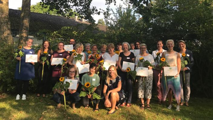 Gruppenbild mit Auszeichnungsträgern des Sun Pass