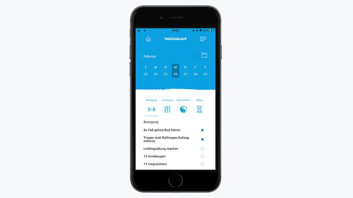 Smartphone mit Bildausschnitt missionmacher-App zum Tagesablauf